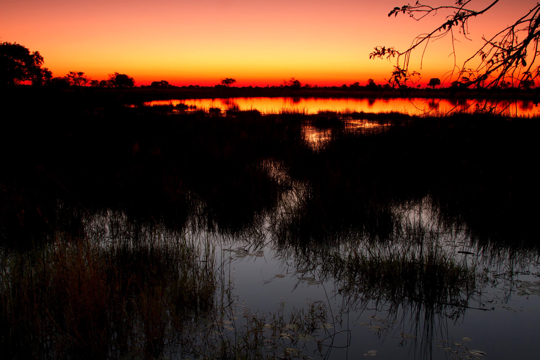 Zonsondergang boven de Okavango Delta Botswana