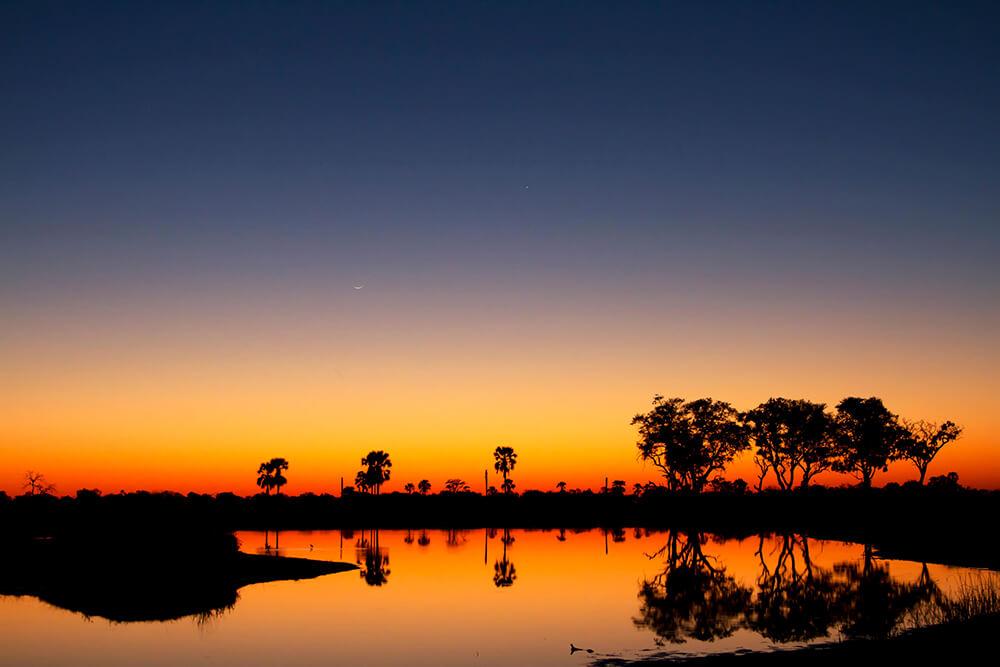 Betoverende zonsondergang Okavango Delta Botswana